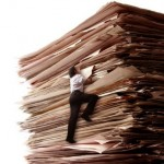 If you are drowning in discovery paperwork, you may want to consider hiring legal representation.
